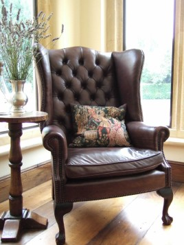 Leather winged arm chair